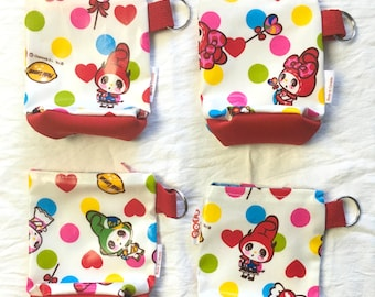 Sofs offers a pack of 4 small laminated japanese fabric and neoprene pouch. In candy style.