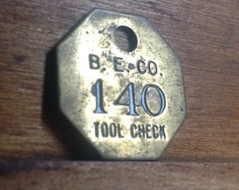 Vintage Brass B. E. Co. Tool Check Tag. Number 140.  Industrial Craft Supplies.