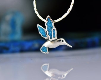 Sterling silver detailed Hummingbird in flight pendant with inlaid Kingman Turquoise