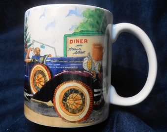 A classic auto ride passing the coffee sign. Can you feel the breeze in your hair and the comfort of a cup of coffee