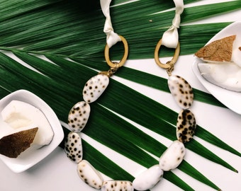 Statement-chain of failed Cowrie shell with satin ribbon