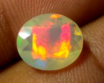 1.6 Carat 10.6x9x5.1 MM Natural Faceted Ethiopian Mulit Color Red Fir Opal Oval Shape Cut Stone, Faceted Ethiopian Opal Loose Gemstone
