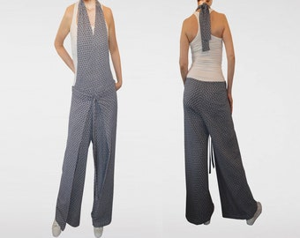 Jumpsuit fit and ultra wide legs.
