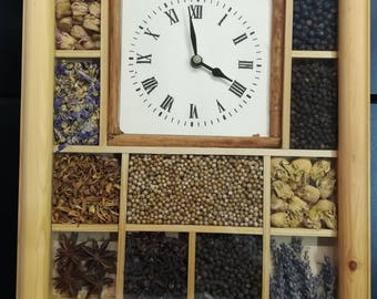 Department clock, solid wood with seeds and dried flowers. Decorative.
