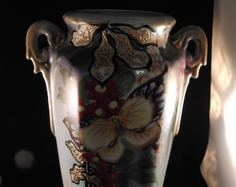 Vintage porcelain vase with butterflies and flowers