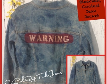 Stretchy size small women's Jean jacket with a WARNING label on back that washes and dries nicely on med settings.