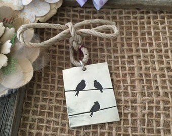 Three little birds pendant