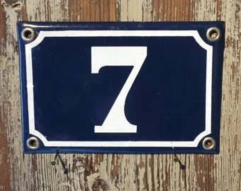 Vintage French enamel house number - number 7. Traditional blue and white