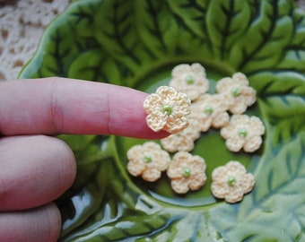 Mini crochet flower appliques with a bead in the middle. Embellishments for your clothes or use for many other things like craft supplies.