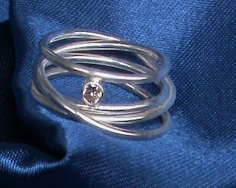 Infinity birthstone ring.  An endless coil of sterling silver set with a 3mm champagne cubic zirconia.
