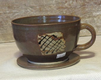 large cup and saucer
