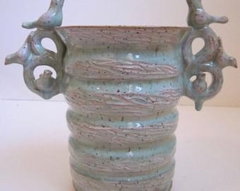 Green speckled bird vase