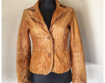 Tan leather jacket by MNG