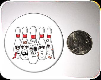 Bowling Pins Beat Up Bowling Pins Refrigerator Magnet 2 1/4 inches in diameter