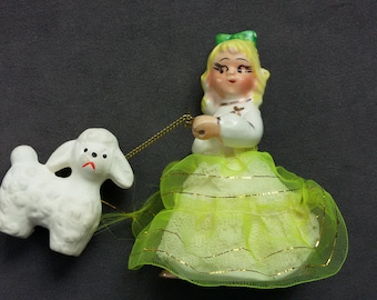 Vintage Girl walking a Poodle on a Chain Leash, Porcelain Figurines
