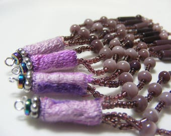 Dangles,charms, embellishment. Set of 4 mauve Fiber, crystal and beaded embellishments.