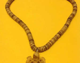 "Wood Necklace. Measures 18"" Long With A 46 mm Wood Turtle."