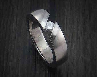 Titanium tension set moissanite ring with palladium inlays custom made wedding band