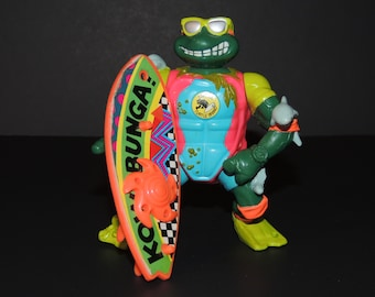 1990 Mike The Sewer Surfer Teenage Mutant Ninja Turtles TMNT Loose Action Figure / Toy with Sewer-Worthy Surfboard