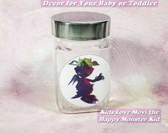 "Toddlers' or Baby's Nursery Decor-'Movi' the Happy Monster Kid-Glass Storage Jar. 3.75"" Square x 4"" High. Beautiful New Baby or Shower Gift!"