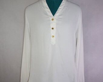 White blouse with gold buttons