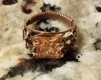 Red Bronze wraps a dark champagne CZ in a Unisex design.  The size 10 ring sports a 10mm square stone.