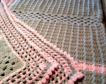 enjoy this beautiful gray and pale pink afghan with beautiful decorative border