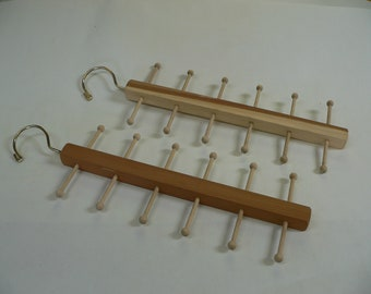A pair of  Tie Racks, aromatic cedar and ginger bread pegs