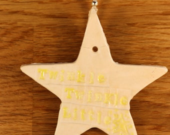 Twinkle Twinkle Little Star Handmade Pottery Star, Hand painted with white and yellow glazes and a lovely navy and white stitched ribbon.