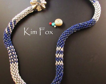 Superduo tubular necklace with silver and royal blue beads handstitched one bead at a time with large silver Sea Urchin Toggle by Kim Fox