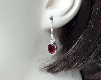 Faceted garnet earrings set in 92.5, sterling
