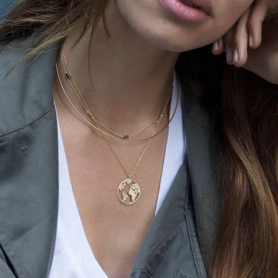 World map necklace globetrotter necklace gold map necklace gumiabroncs Choice Image
