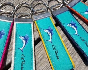 Sailfish on teal ribbon key ring backed with different colors, silver hardware