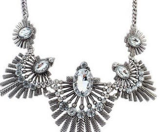 Feather statement metal necklace