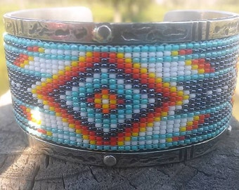 Sterling silver cuff bracelet with seed beads and turquoise accents