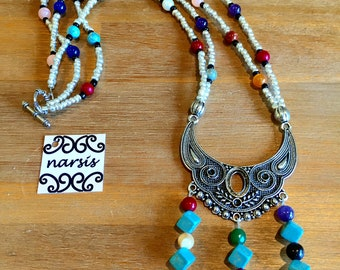 Boho style,one-off a kind,tribal necklace, decorative silver finish pendant,statement necklace,medium length necklace,beaded necklace.