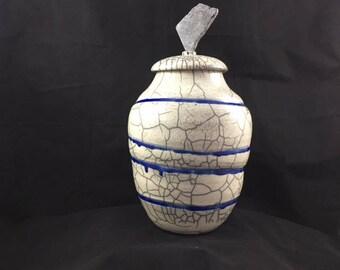 Raku urn with stone finial