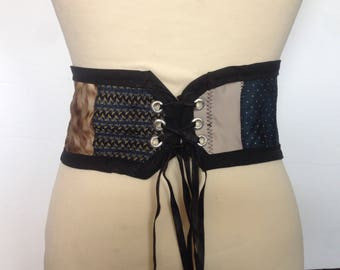 One of a kind upcycled silk tie corset style belt. Free shipping within Canada!