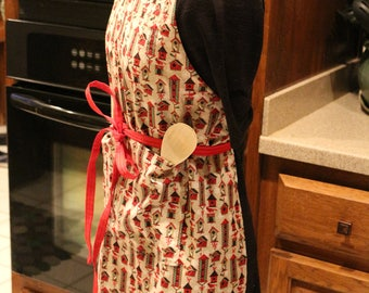 One size fits most - Christmas print apron.  Red birdhouses with cardinals, other birds
