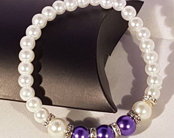 Glass pearl bracelet with rhinestone spacers