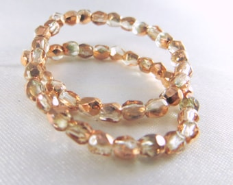 1 strand 50 Copper Half Tone Rose Gold and clear Czech Fire Polished 3mm beads