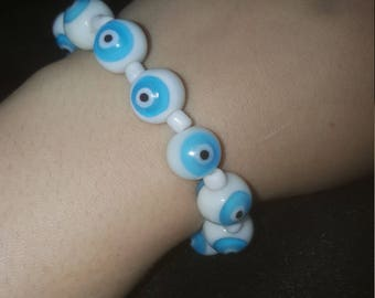 Evil eye stretch bracelet-sphere shape glass beads with small white glass spacer beads