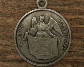 Antique silvered religious angel medal pendant holy blood of Hoogstraten a town in Belgiuml