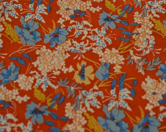 Multicolor flowers on red/garden of rare blooms fabric cloth