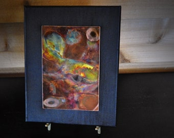 "Abstract ""Painting"" on copper, mounted on black canvas. Title: Feathered Serpent."