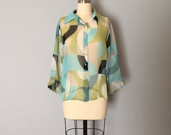 geometric print blouse | sheer minimalist blouse | sea glass green and blue ruffled sleeves blouse