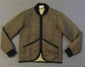 1970's, quilted, nylon, work jacket, in drab olive, with black trim, Men's size Small, Women's size Medium