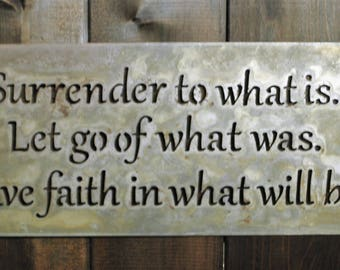 "Surrender"", is a laser cut metal sign with a natural finish. It measures 16"" wide and 15"" tall."
