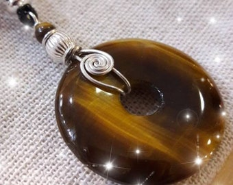 Tigers Eye jewellery gemstone pendant on black cord with sterling silver wire wrap design. boho  jewellery handmade