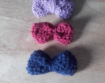 Cute little crochet bow tie hair clips in mauve,navy and burgundy